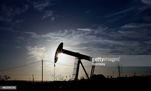 A pumpjack operates at the Inglewood Oil field in Los Angeles California US on Thursday Oct 19 2012 Oil extended losses below $60 a barrel amid...