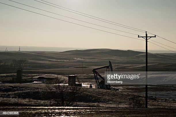 A pumpjack stands on the site of an oil well outside Williston North Dakota US on Thursday Feb 12 2015 A plunge in global energy prices that has put...