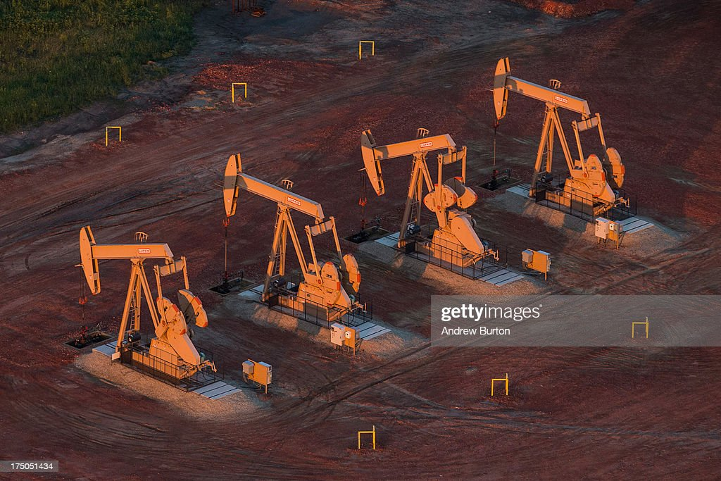 Pumpjacks are seen in an aerial view in the early morning hours of July 30, 2013 near Watford City, North Dakota. North Dakota has seen a boom in oil production thanks to new drilling techniques including horizontal drilling and hydraulic fracturing.