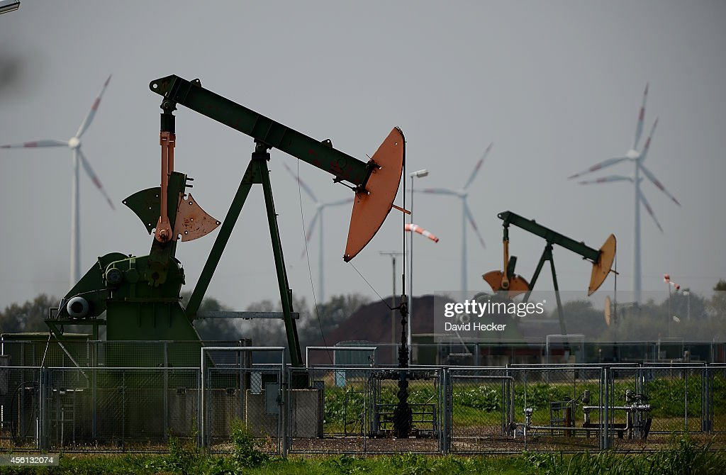 Pumpjacks pump petroleum from the ground on September 23 2014 near Ruehlermoor Germany Germany produces approximately three million tons of petroleum...