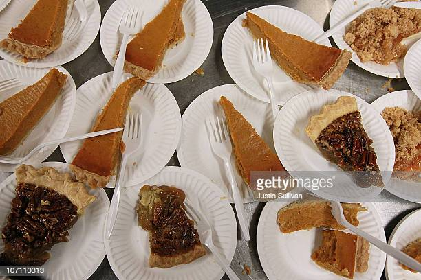Pumpkin and pecan pies sit on a table before being given away as part of a free Thanksgiving meal at CityTeam Ministries on November 24 2010 in...