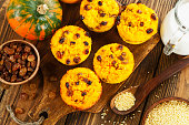 Pumpkin cake with  millet and raisin on the wooden table
