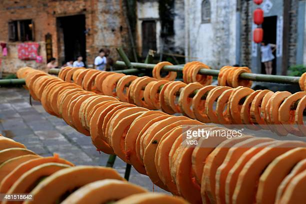 Pumpkin chips dry in the sun during China's First Cultural Festival for Autumn Harvests on June Sixth according to Chinese canlendar at Huangling...