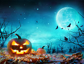 Jack O' Lanterns Glowing At Moonlight In The Spooky Night