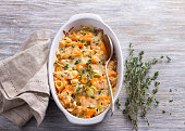 Pumpkin Gratin with leek, thyme and cheese on a gray background, selective focus