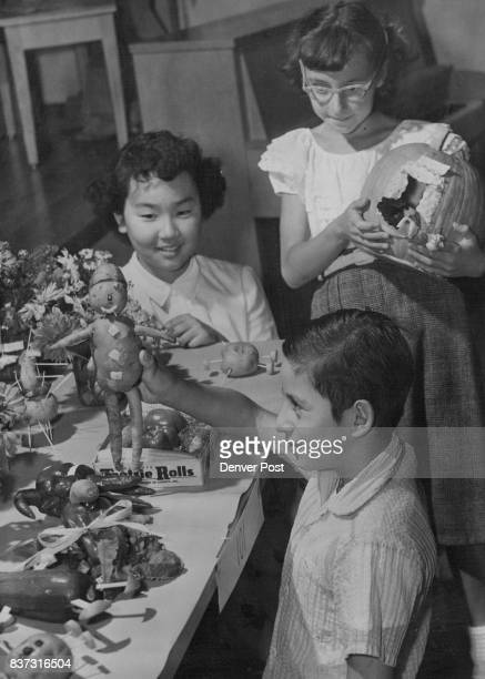 SEP 18 1953 ***** Pumpkin In the photo at right Eve Takata of 4125 Vallejo St Kenneth Rendon of 4034 Zuni St and Patricia Laird of 1781 W Scott PI...