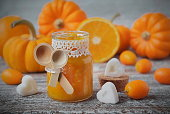 pumpkin jam with oranges on a vintage wooden table