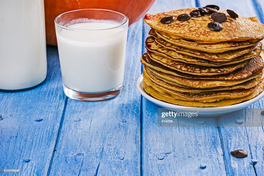 Pumpkin pancakes and milk : Stock Photo