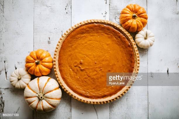 Pumpkin Pie on Rustic Background
