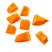 Pumpkin pieces cut in a  cube slice isolated on white background. Diced Pumpkin, close up.