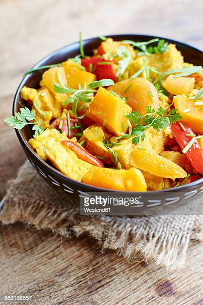 Pumpkin risotto with tofu, apricots, bell pepper and herbs
