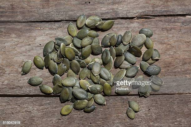 Pumpkin seeds on wooden table