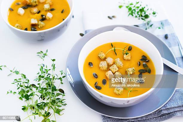 Pumpkin soup served with croutons and pumpkin seeds