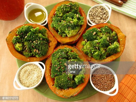 Pumpkin stuffed with broccoli : Stock Photo