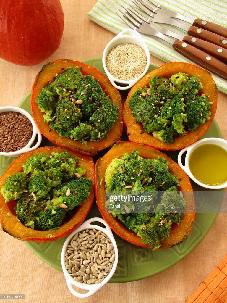 Pumpkin stuffed with broccoli : Stock Photo