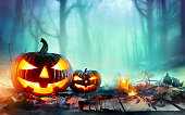 Jack O' Lantern In Woodland With Mist
