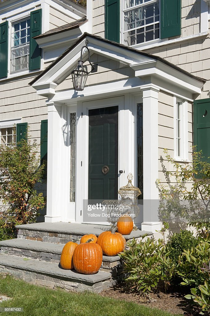 Pumpkins on Front Door Steps : Stock Photo