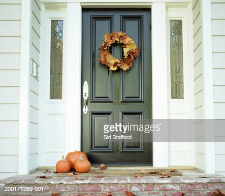 Pumpkins on front step of house