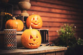 Pumpkins on front step with halloween decorations