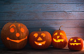pumpkins on wooden background with copy space