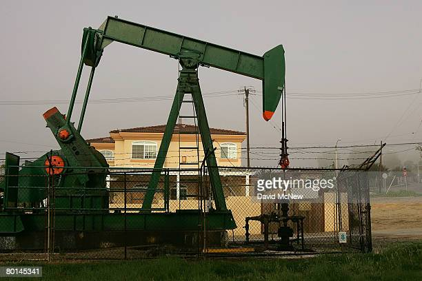 Pumps draw petroleum from oil wells near homes as the cost of crude oil tops $104 per barrel in its surge to new record high prices March 6 2008 in...