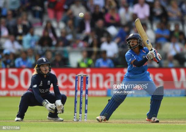 Punam Raut of India plays a shot as Sarah Taylor of England looks on during the ICC Women's World Cup 2017 Final between England and India at Lord's...
