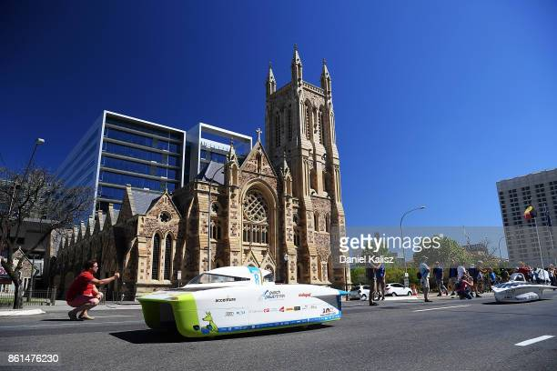Punch Powertrain Solar Team vehicle 'Punch Two' from Belgium competes during a street parade for the 2017 Bridgestone World Solar Challenge down...