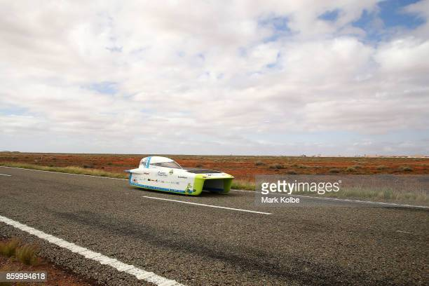 Punch Powertrain Solar Team vehicle 'Punch Two' from Belgium races outside of Coober Pedy on Day 4 of the 2017 Bridgestone World Solar Challenge on...