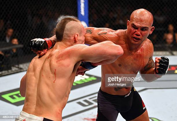 punches Rory MacDonald in their UFC welterweight title fight during the UFC 189 event inside MGM Grand Garden Arena on July 11 2015 in Las Vegas...