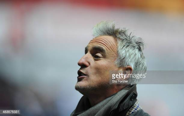 TV pundit David Ginola looks on before the Barclays Premier League match between Swansea City and Newcastle United at the Liberty Stadium on December...