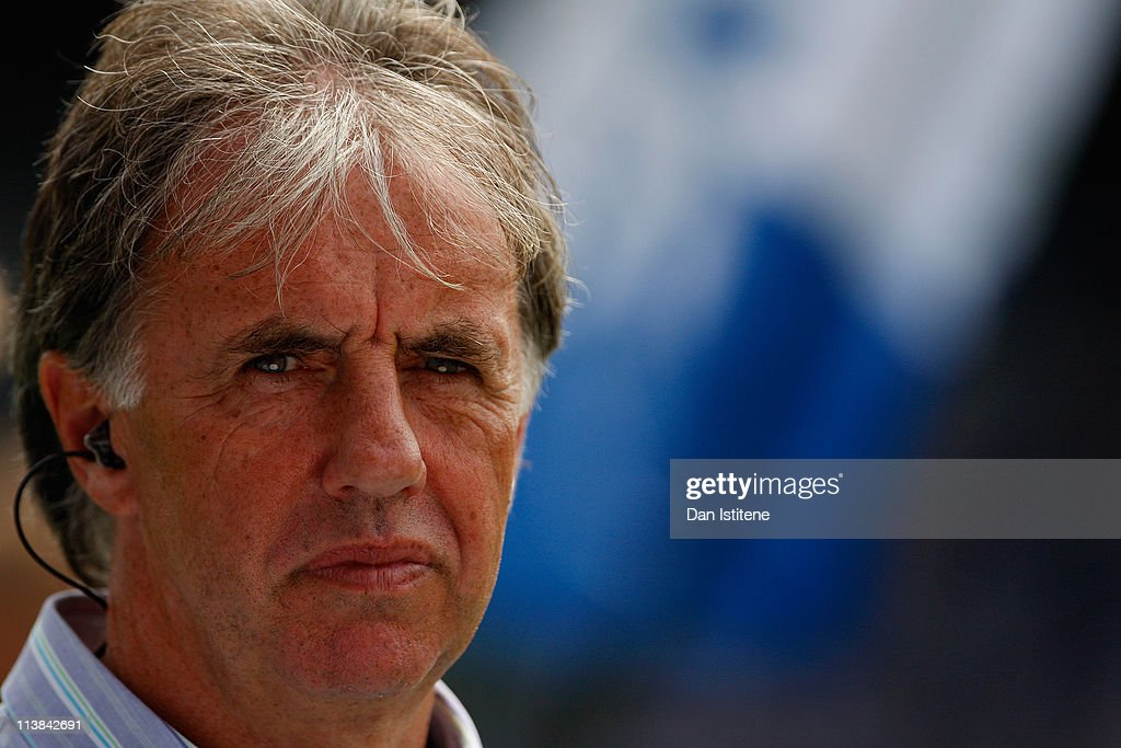 BBC pundit Mark Lawrenson looks on as prepares for the start of the npower Championship match between Queens Park Rangers and Leeds United at Loftus...