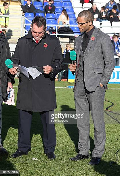 ITV pundit Martin Allen looks at the player stats as Clarke Carlisle looks on prior to the FA Cup with Budweiser match between Bishop's Stortford and...
