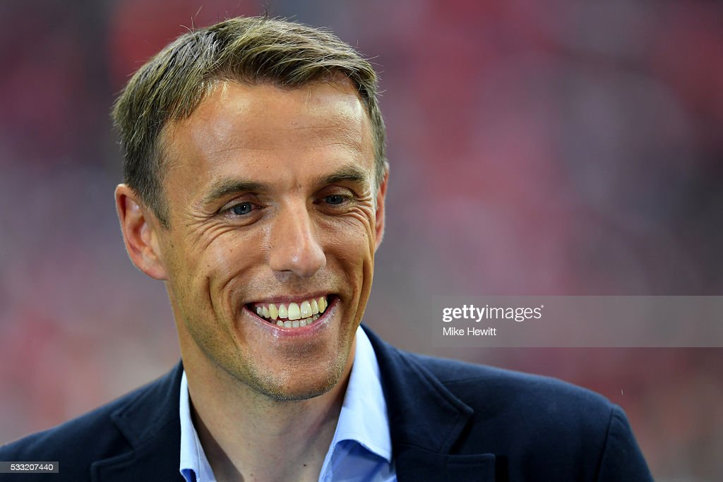 Pundit Phil Neville smiles prior to The Emirates FA Cup Final match between Manchester United and Crystal Palace at Wembley Stadium on May 21 2016 in...