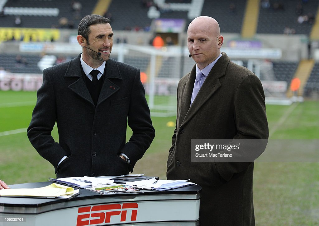 TV pundits and ex Arsenal players Martin Keown and John Hartson before the FA Cup Third Round match between Swansea City and Arsenal at the Liberty...