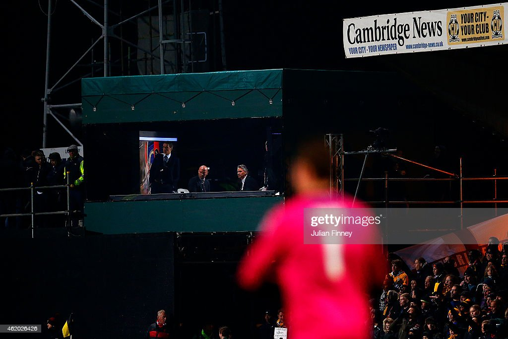 TV pundits and former players Phil Neville Alan Shearer and Gary Lineker watch the action during the FA Cup Fourth Round match between Cambridge...