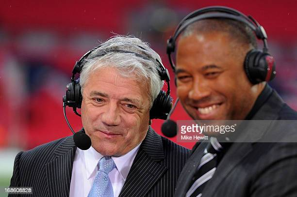 Pundits Kevin Keegan and John Barnes look on after the FA Cup with Budweiser Final between Manchester City and Wigan Athletic at Wembley Stadium on...