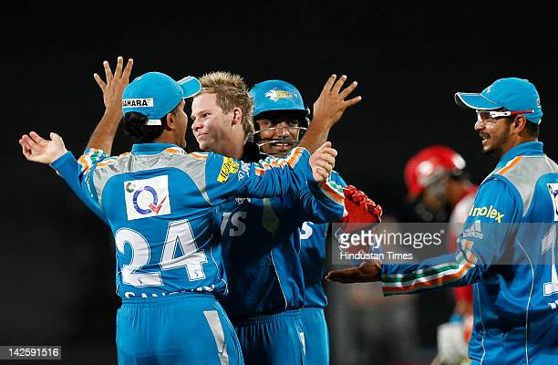 Pune 08 April 2012 Sports Pune warriors player Steve Smith celebrate the wicket of Adams Gilchrist during match between Pune Warrior India vs Kings...