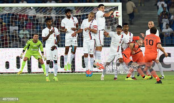 Pune City FC footballers play against members of the Delhi Dynamos FC during their Indian Super League football match in New Delhi on October 14 2014...