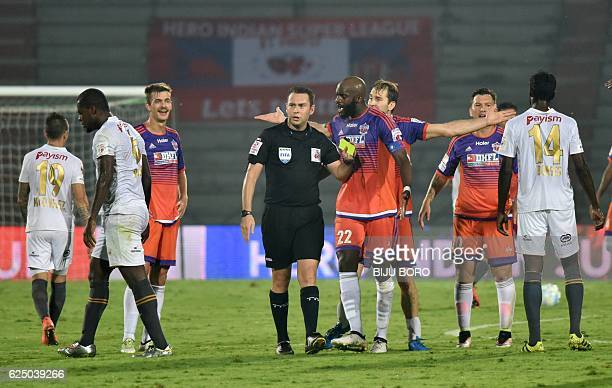 FC Pune City midfielder Mohammed Lamine Sissoko argues with referee Nick Waldorn during the Indian Super League football match between North East...