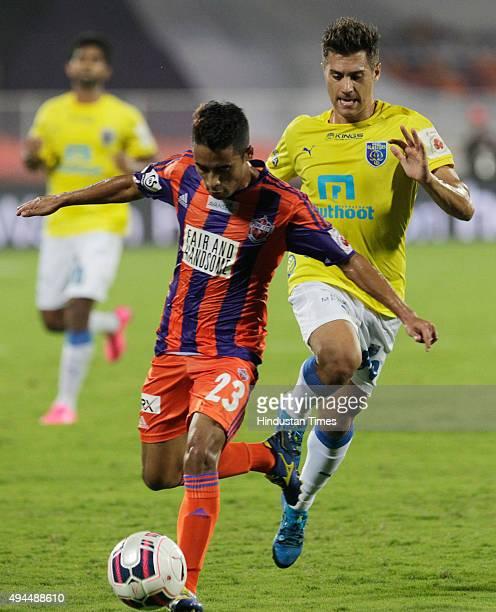 Pune City player Bikash Jairu dribble past Kerala Blasters FC player Josu during a match of Hero Indian Super League 2015 at Shree Chhatrapati...