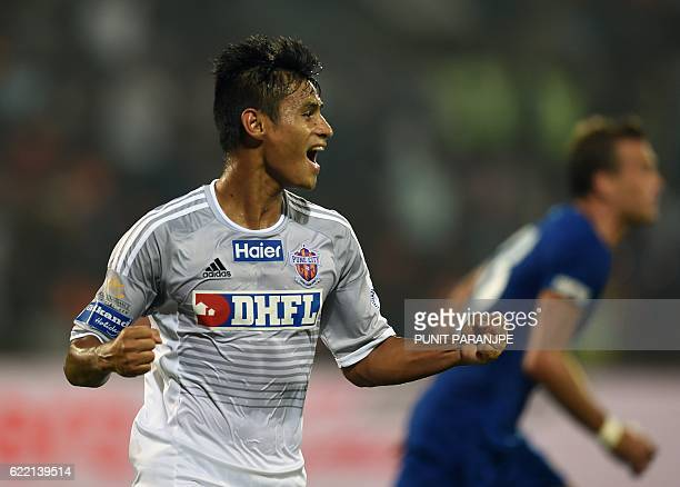 FC Pune City player Eugeneson Lyngdoh celebrates after scoring a goal during the Indian Super League football match between FC Pune City and Mumbai...