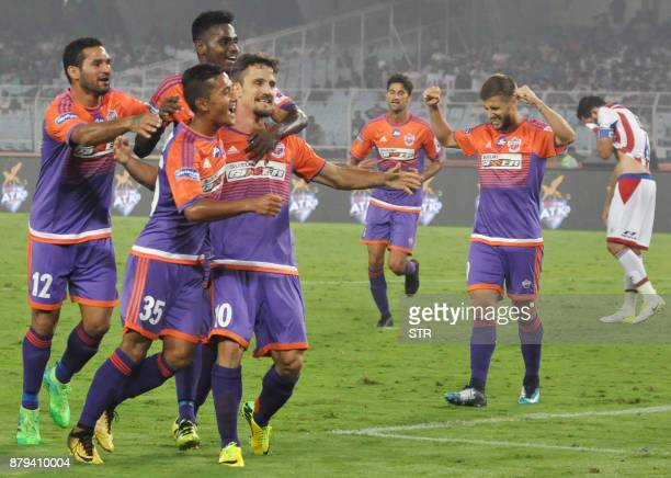 FC Pune City players celebrates after scoring a goal during the Indian Super League football match between ATK and FC Pune City at The Salt Lake...