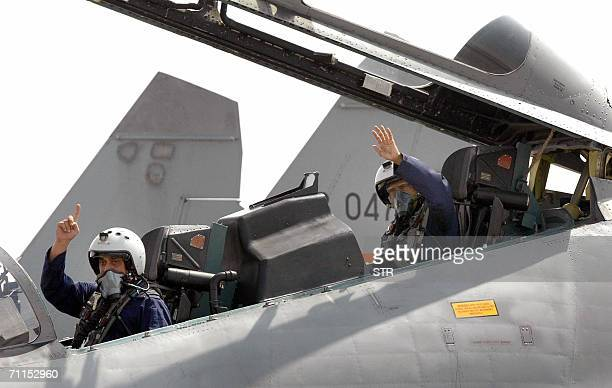 Indian President APJAbdul Kalam and Wing Commander Ajay Rathore wave from the cockpit of the latest supersonic fighter aircraft Sukhoi30 MKI before...