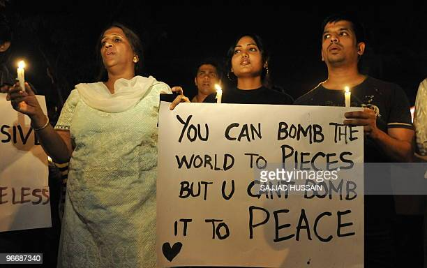 Pune residents hold a peace rally in their city on February 14 2010 in protest against the previous day's terror attack on the landmark eatery German...