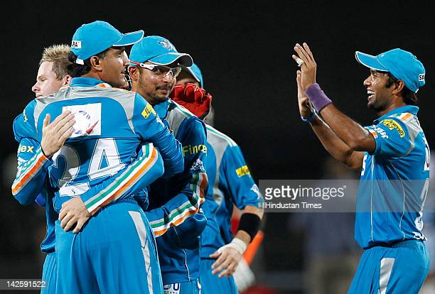 Pune Warriors captain Saurav Ganguly hugs Steve Smith after Kings XI Punjab batsman Adams Gilchrist was run out during DLF IPL 5 cricket match played...