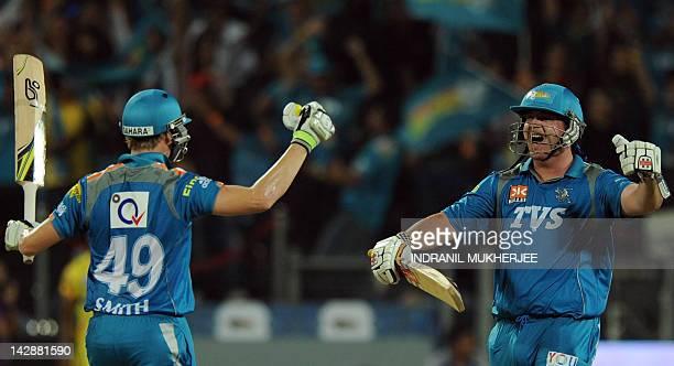 Pune Warriors India batsmen Steven Smith and Jesse Ryder celebrate after scoring the winning shot in the IPL Twenty20 cricket match between Pune...