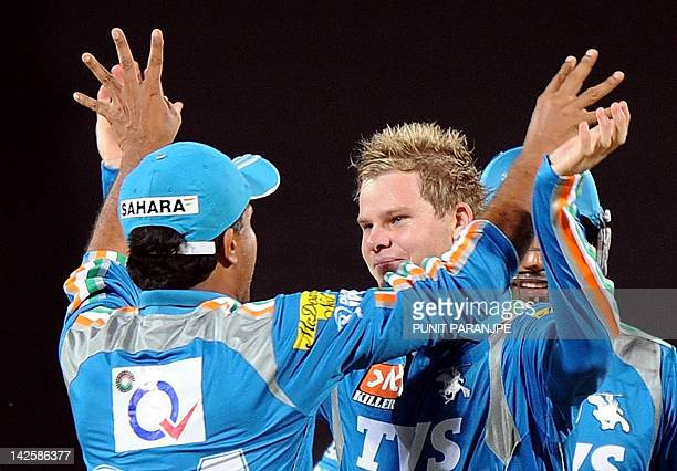 Pune Warriors India captain Sourav Ganguly celebrates with a team mate Steven Smith after the wicket of Kings XI Punjab captain Adam Gilchrist during...