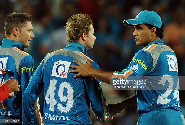 Pune Warriors India captain Sourav Ganguly speaks to team mates Michael Clarke and Steve Smith during the IPL Twenty20 cricket match between Pune...