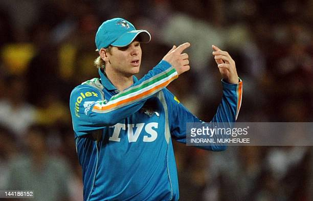 Pune Warriors India captain Steve Smith gestures for a fielding change during the IPL Twenty20 cricket match between Pune Warriors India and Royal...