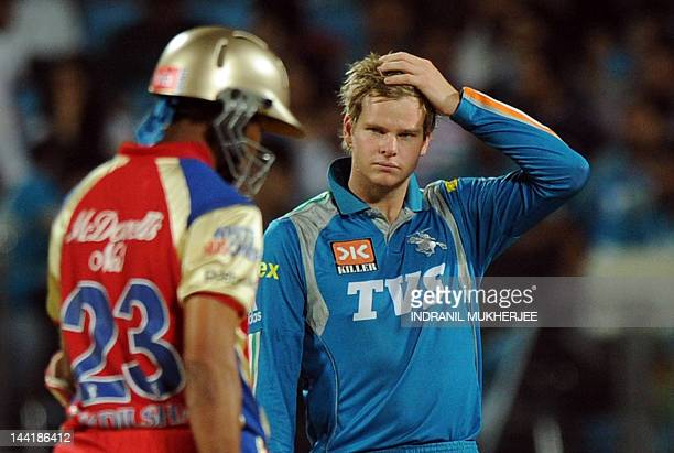 Pune Warriors India captain Steve Smith reacts after a shot by unseen Royal Challengers Bangalore Chris Gayle during the IPL Twenty20 cricket match...